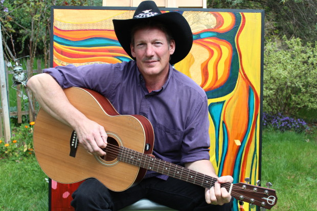 Country Singer Darrin Wayne in front of art by Cammy Davis